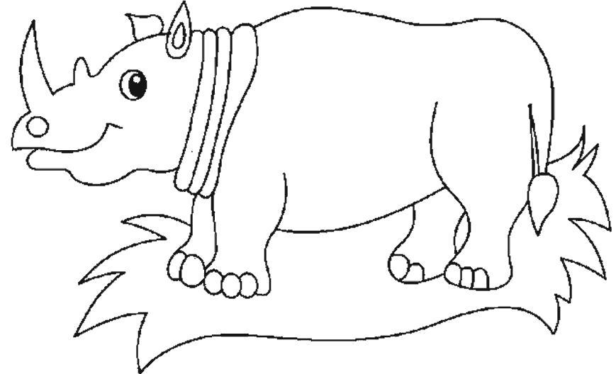 Раскраска носорог стоит на траве. Скачать Носорог.  Распечатать Дикие животные